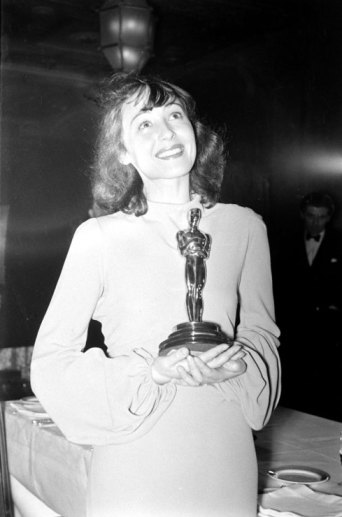 Luise Rainer, the first woman to win two Oscars, holds her Best Actress award for her performance in The Great Ziegfeld during the 1937 Academy Awards ceremony.